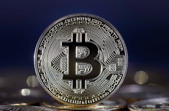 A photo illustration providing a visual representation of the digital Cryptocurrency - Bitcoin