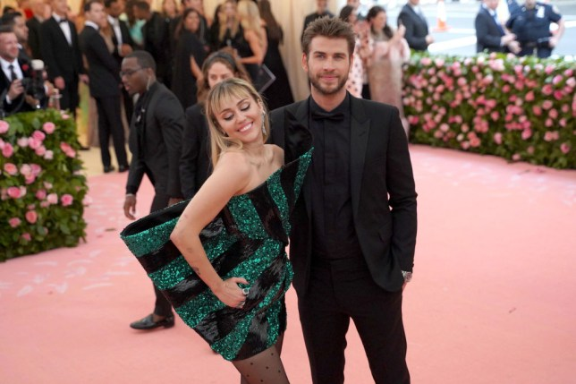Miley Cyrus and Liam Hemsworth posing together at an event at The Metropolitan Museum Of Art
