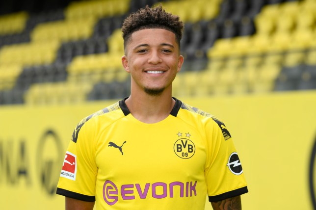 Manchester United target Jadon Sancho smiles in a Borussia Dortmund shirt