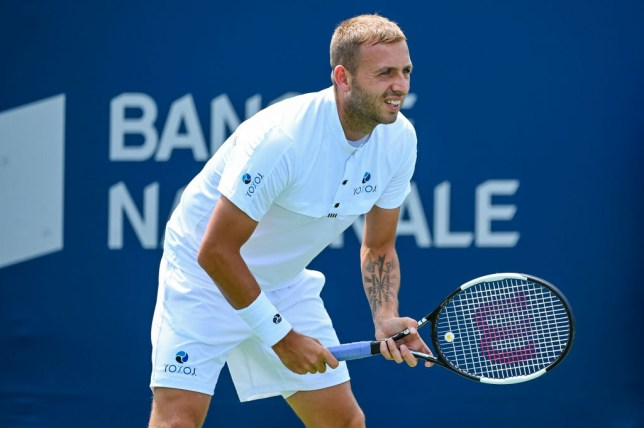 Dan Evans prepares to return a serve in a match ahead of the US Open