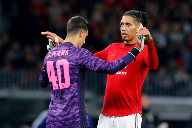 Chris Smalling embraces Manchester United goalkeeper Joel Pereira