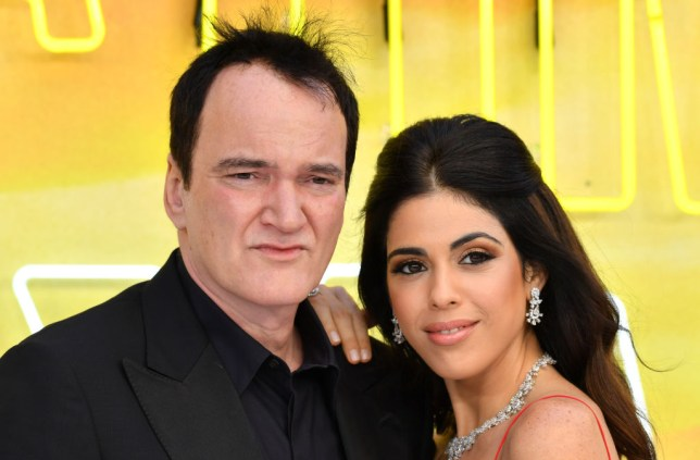 Quentin Tarantino and Daniella Pick pose together at Once Upon a Time in Hollywood premiere