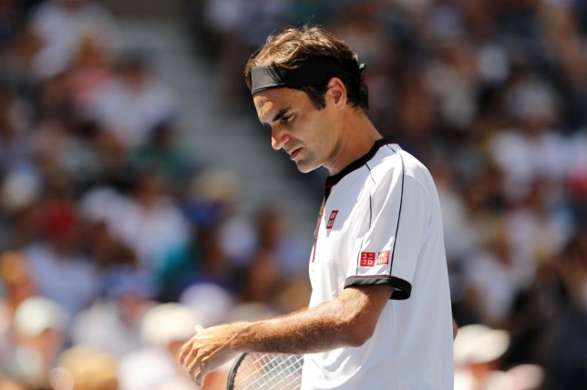 Roger Federer looks concerned during his win over Dan Evans at the US Open
