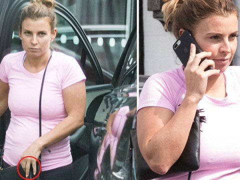 Coleen Rooney looks downcast as she ditches wedding ring after Wayne is 'seen getting into hotel lift with woman on night out'