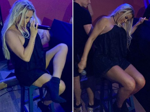 Katie Price 'falls off stool' as she makes boozy nightclub performance following latest surgery