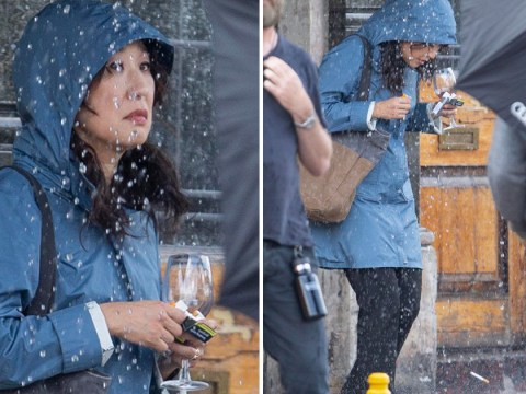 Killing Eve's Sandra Oh despairs over British weather as she clutches wine in downpour filming for new season