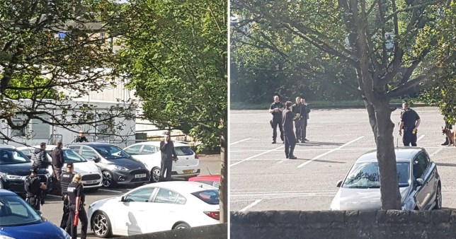 Armed police in four hour stand-off with man 'holding knife to his throat'
