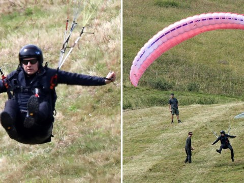 Tom Cruise soars majestically as action man expertly manoeuvres paraglider in field