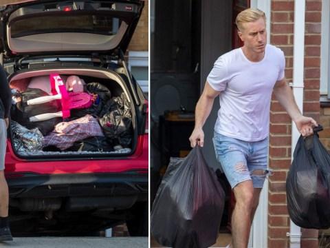Kris Boyson piles Katie Price's kids' toys into bin bags as he rids his home of her stuff following split