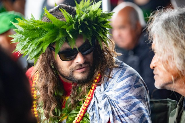 Actor Jason Momoa speaks with his uncle, Titus Kinimaka, while visiting elders and Native Hawaiian protesters blocking the construction of a giant telescope on Hawaii's tallest mountain, at Mauna Kea Access Road