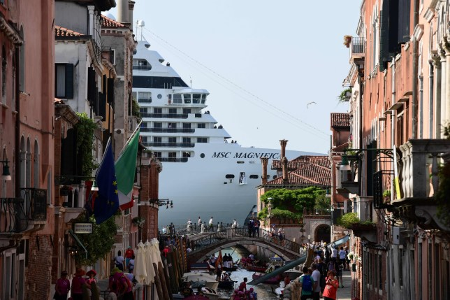 (FILES) In this file photo taken on June 9, 2019 MSC Magnifica is seen from one of the canals leading into the Venice Lagoon in Venice. - Venice has appealed to top European cruise ship destinations, from Amsterdam to Barcelona, Dubrovnik and Marseille, to unite in tackling the dangers and environmental impact of hulking liners, port authorities said on August 1, 2019. The rallying cry for new rules to force companies to adapt their ships to the historical port cities that host them follows a collision between a cruiser and tourist boat in Venice that forced tourists to run for their lives. (Photo by Miguel MEDINA / AFP)MIGUEL MEDINA/AFP/Getty Images