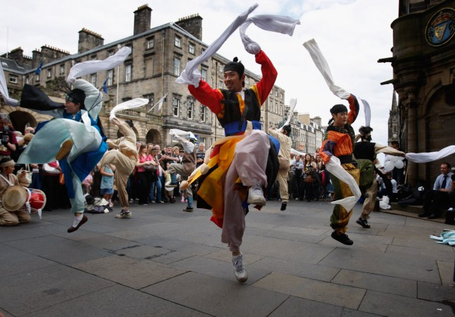 street entertainers peforming as part of the fringe during the edinburgh festival