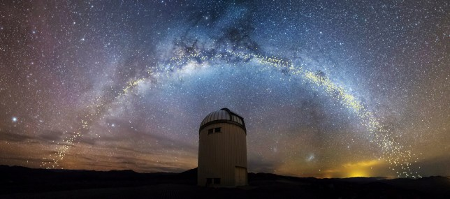 The warped shape of the stellar disk of the Milky Way galaxy, determined by mapping the distribution of young stars called Cepheids with distances set out in light years, is seen over the Warsaw University Telescope at Las Campanas Observatory in Chile, in an artist's rendition released August 1, 2019. Jan Skowron/University of Warsaw/Handout via REUTERS. THIS IMAGE HAS BEEN SUPPLIED BY A THIRD PARTY. NO RESALES. NO ARCHIVES. MANDATORY CREDIT