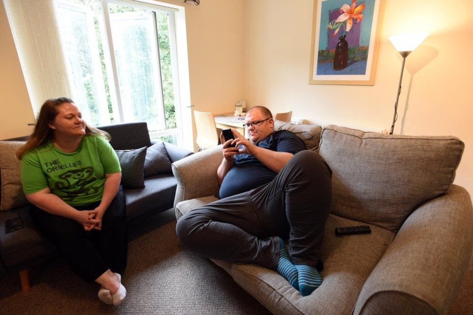 Charlotte and Jon Grinham in the living room of their apartment in Halifax.
