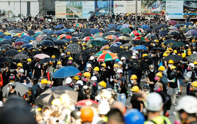 Protesters carry umbrellas as they attends a demonstration in Hong Kong
