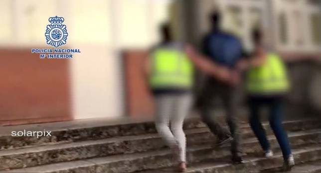 man being arrested in Madrid