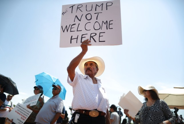 ***BESTPIX*** EL PASO, TEXAS - AUGUST 07: Miguel de Anda, born and raised in El Paso, holds a sign reading 'Trump Not Welcome Here' at a protest against President Trump's visit following a mass shooting, which left at least 22 people dead, on August 7, 2019 in El Paso, Texas. Trump is scheduled to visit the city today. A 21-year-old white male suspect remains in custody in El Paso which sits along the U.S.-Mexico border. (Photo by Mario Tama/Getty Images)