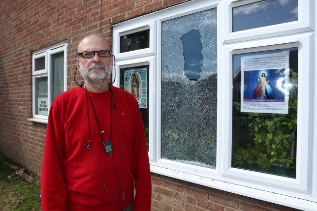 A devout Christian who displayed a controversial anti-abortion poster at his house has called in cops after a 'missile' was thrown through his window. William Astor, 63, said he placed the poster - which read 'pray to end abortion' - in his bedroom window after attending the March for Life demonstration in London earlier this year. Caption: William Astor, pictured beside the smashed window at his home in Radford, Nottingham, which displays various Christian and anti-abortion posters