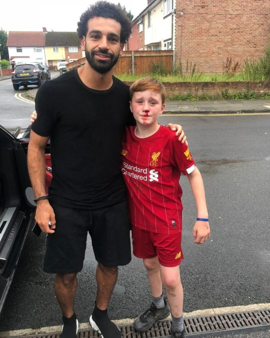 buy popular 5c65a 39786 Liverpool's Mo Salah poses with boy who ran after him and ...