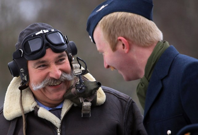 LYNEHAM, ENGLAND - NOVEMBER 30: Station Warrant Officer Nick Dale (L) from No. 1 Air Mobility Wing based at RAF Lyneham in WWII era RAF dress, sporting his Movember moustache, shares a joke on November 30, 2010 in Lyneham, England. The airmen at the RAF base, which is home to the RAF's Hercules force and handles repatriation flights from Afghanistan, have grown their moustaches as part of the global sponsored charity event Movember to raise money for prostrate cancer. (Photo by Matt Cardy/Getty Images)