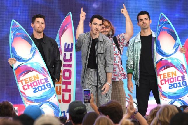 Nick Jonas, Kevin Jonas and Joe Jonas of Jonas Brothers accept the Teen Choice Decade Award