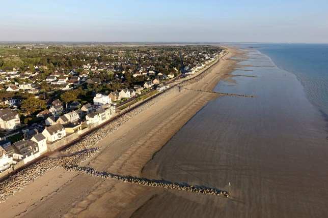 Agon-Coutainville (Lower-Normandy, north-western France): aerial view of the waterfront with holiday homes protected by laying ripraps and the dyke. (Photo by: Andia/Universal Images Group via Getty Images)