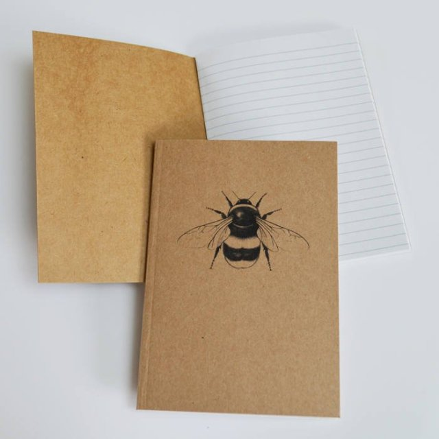 Brown sustainable notebook on a white background