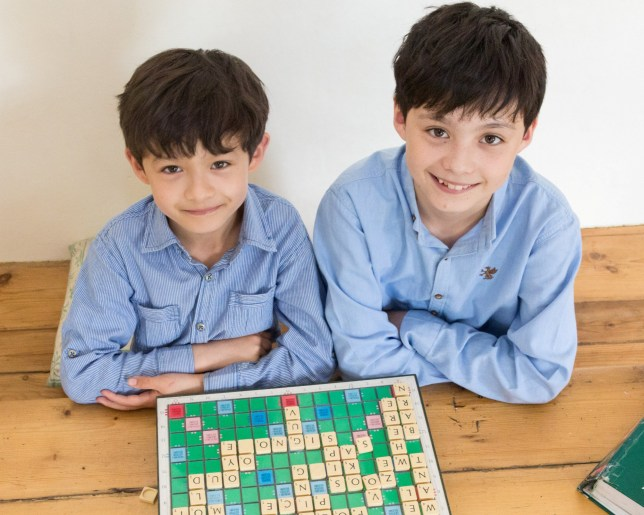 Brothers Reuben (right) and Josh Moisey with a scrabble board
