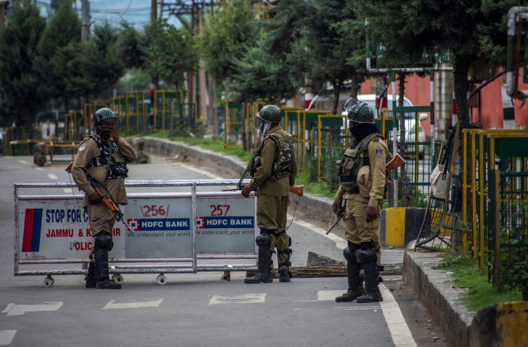 SRINAGAR, KASHMIR, INDIA - AUGUST 17: Indian government forces stand guard amid curfew like restrictions in the old city, after Indian authorities revoked Article 370 and Article 35A, on August 17, 2019 in Srinagar, the summer capital of Indian administered Kashmir, India. Curfew like restrictions remain in place in Kashmir for the thirteenth consecutive day after India revoked articles 370 and 35A, and phone and internet services also remained suspended. Article 35A of the Indian Constitution was an article that empowered the Jammu and Kashmir state's legislature to define permanent residents of the state and provided special rights and privileges to those permanent residents, also preventing non-locals from buying or owning property in the state. Prior to 1947, Jammu and Kashmir was a princely state under the British Empire. It was added to the Constitution through a Presidential Order. The Constitution Order 1954, (Application to Jammu and Kashmir) was issued by the President of India on 14 May, 1954 in accordance with Article 370 of the Indian Constitution, and with the concurrence of the Government of the State of Jammu and Kashmir. Kashmir has been a state under siege, with both India and Pakistan laying claim to it. Human rights organizations say more than 80,000 have died in the two decade long conflict with the Indian government claiming the number as 42,000. (Photo by Yawar Nazir/ Getty Images)