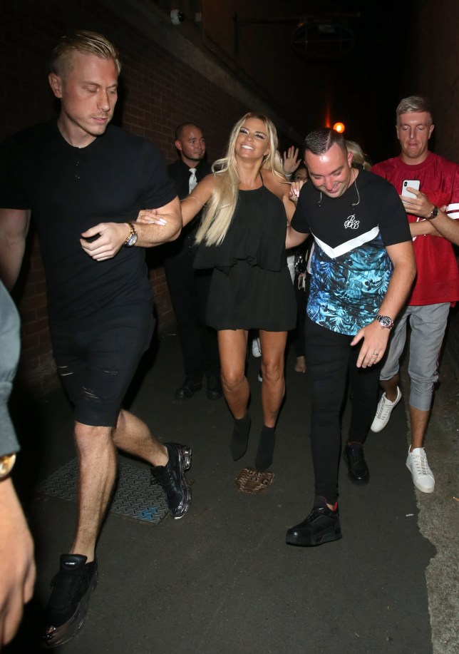 18 August 2019 - EXCLUSIVE. Katie Price is seen here arriving at The Cricketers Pub in Taunton, Somerset for her 'Hurricane' single launch with Rick Live. Katie arrived at The Cricketers Pub at just after midnight worse for wear, arm in arm with Kris Boyson and Rick Live. Kris & Katie have both recently returned to the UK after some cosmetic surgery. Katie was seen leaving the club at around 12.45am still looking worse for wear and helped to her car by Kris Boyson & Rick Live once again. Credit: GoffPhotos.com Ref: KGC-49 **Exclusive to GoffPhotos.com - Newspapers Allrounder - Magazines Double Space Rates Minimum Fee of ??150 - Online/Web Must Call Before Use**