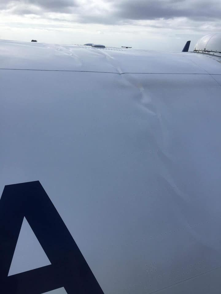 Another photo showing damage inflicted on roof of Boeing 757