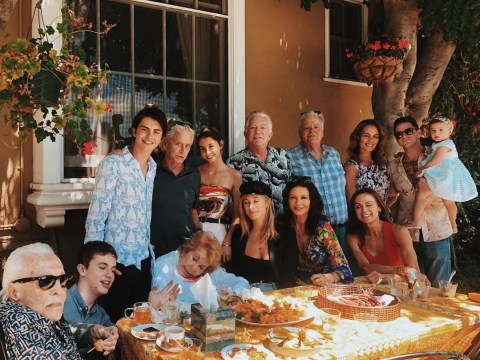 Michael Douglas and Catherine Zeta Jones pose with four generations of family