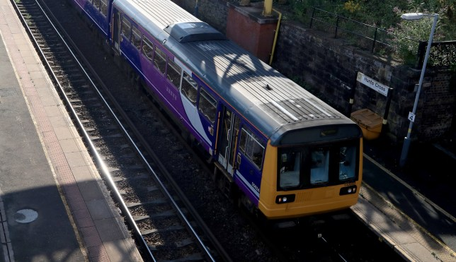 """A Northern Rail train travels through Hunts Cross Station in Liverpool. The Prime Minister has been urged to step in personally to end rail """"chaos"""" in the North of England after summer disruption is thought to have cost businesses more than £1 million a day at its height."""