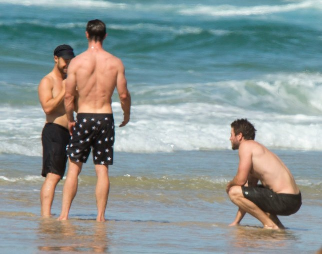 Liam Hemsworth and Chris Hemsworth in Byron Bay