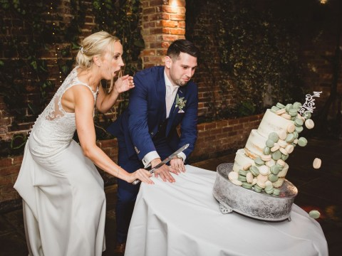 Couple watch as their £450 wedding cake falls to the floor the moment they cut it