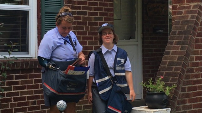 Woman with down syndrome seen in her postal service work uniform