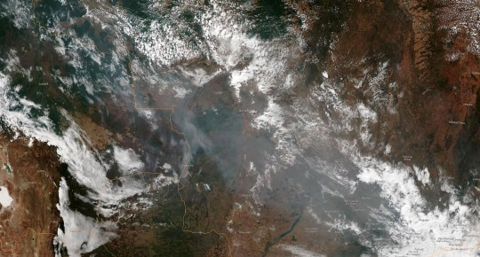"""CORRECTION - This August 21, 2019, satellite image obtained courtesy of the National Oceanic and Atmospheric Administration (NOAA) shows the smoke of several fires in the Brazilian states of Amazonas of Mato Grosso (bottom R) and Rondonia (bottom C). - Wildfires in the Amazon rainforest in northern Brazil have ignited a firestorm on social media, with President Jair Bolsonaro on Wednesday suggesting green groups started the blazes. (Photo by HO / NOAA / AFP) / RESTRICTED TO EDITORIAL USE - MANDATORY CREDIT """"AFP PHOTO / NOAA"""" - NO MARKETING NO ADVERTISING CAMPAIGNS - DISTRIBUTED AS A SERVICE TO CLIENTS --- / The erroneous mention[s] appearing in the metadata of this photo by HO has been modified in AFP systems in the following manner: [of Mato Grosso and Rondonia] instead of [Para, Mato Grosso and Rondonia]. Please immediately remove the erroneous mention[s] from all your online services and delete it (them) from your servers. If you have been authorized by AFP to distribute it (them) to third parties, please ensure that the same actions are carried out by them. Failure to promptly comply with these instructions will entail liability on your part for any continued or post notification usage. Therefore we thank you very much for all your attention and prompt action. We are sorry for the inconvenience this notification may cause and remain at your disposal for any further information you may require.HO/AFP/Getty Images"""
