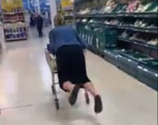 A mum was caught on camera surfing a trolley in a supermarket - before getting buried by her shopping. Jackie Marsh, 45, attempted to ride her trolley down the fruit aisle of a Tesco superstore. But her stunt turned into a hilarious blunder when the trolley tipped backwards - sending her plummeting to the floor. WALES NEWS SERVICE