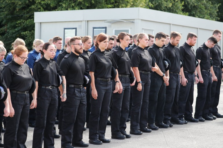 Thames Valley Police officers observe a minute's silence