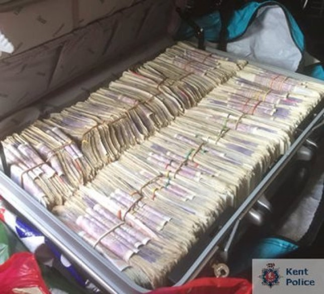 Police find £200,000 stuffed in suitcase during drug raids