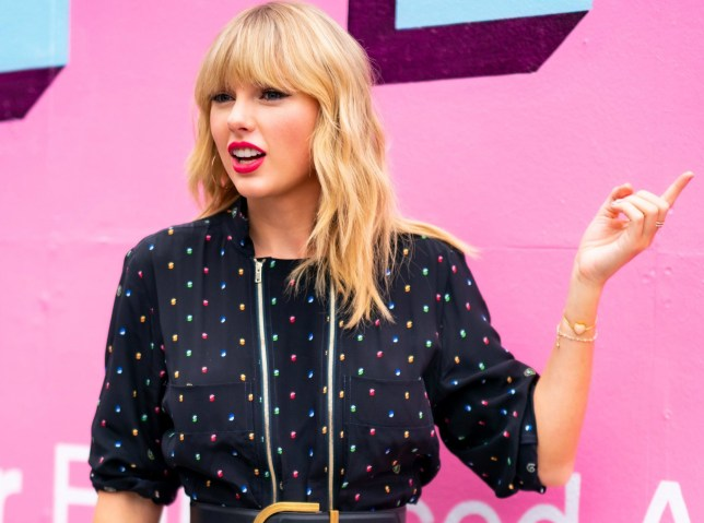 """BROOKLYN, NY - AUGUST 23: Taylor Swift poses in front of a mural introducing her latest album """"Lover"""" on August 23, 2019 in in the Brooklyn borough of New York City. (Photo by Gotham/GC Images)"""