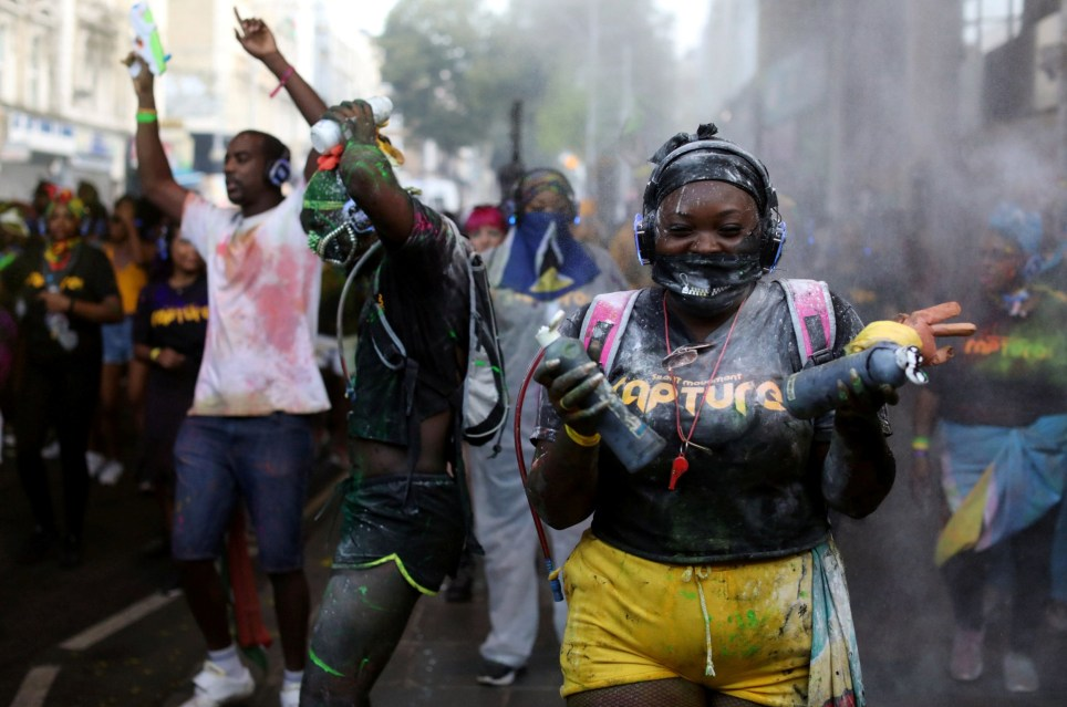 Revellers take part in the Notting Hill Carnival in London, Britain August 25, 2019. REUTERS/Simon Dawson