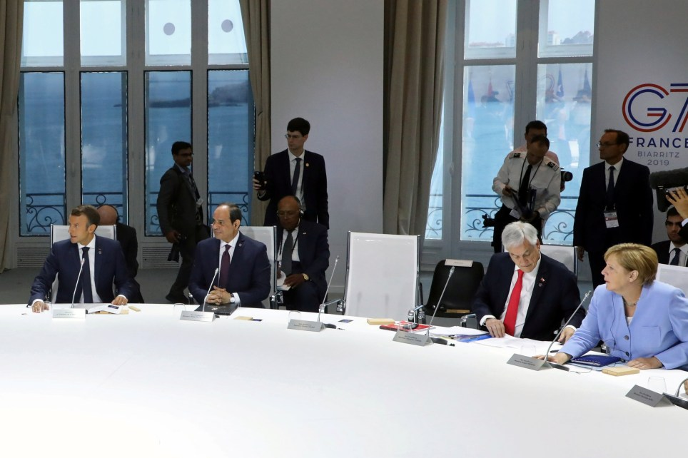 The empty chair of U.S. President Donald Trump is seen during a working session focused on climate change during the G7 Summit in Biarritz, France, August 26, 2019. Ludovic Marin/Pool via REUTERS