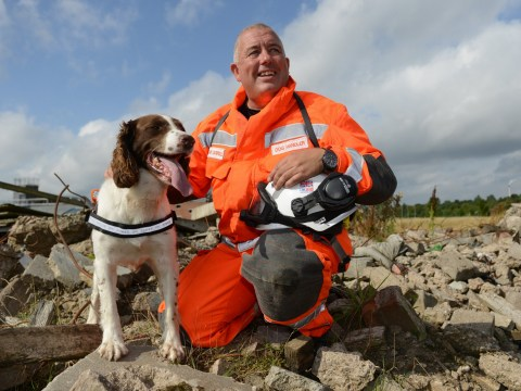 Mac the dog wears boots and goggles for his important job in the fire service