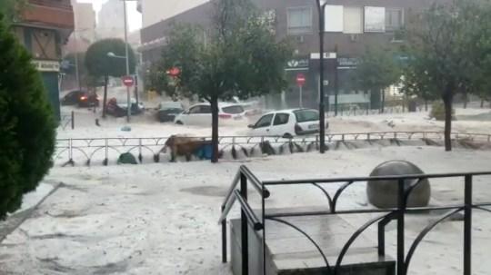 Cars are seen during the heavy rains in Arganda del Rey, Madrid, Spain