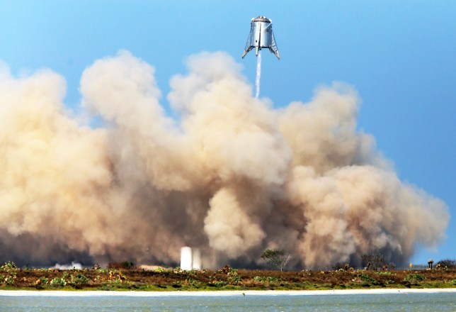SpaceX continue their test on their StarHopper at Boca Chica Beach successfully hovering 500 feet above the launch site and safely landing on SpaceX Launch Pad Tuesday, Aug. 27, 2019, in Brownsville, Texas. (Miguel Roberts/The Brownsville Herald via AP)