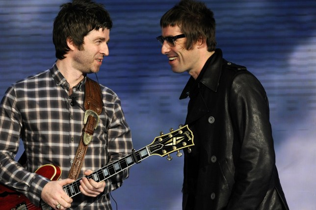 Noel Gallagher and Liam Gallagher performing on stage