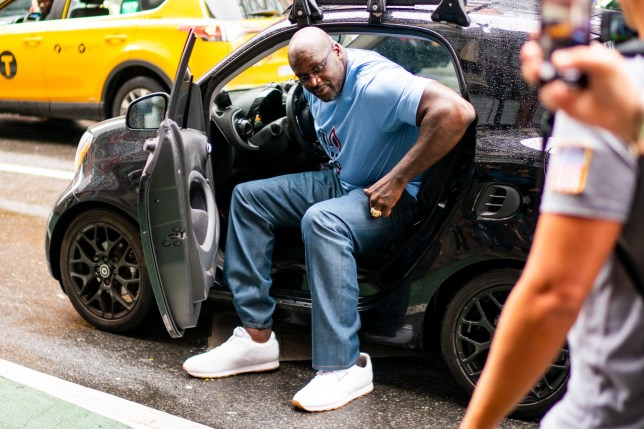 Shaquille O'Neal goes for a tight fitting drive in a SmartCar in New York City