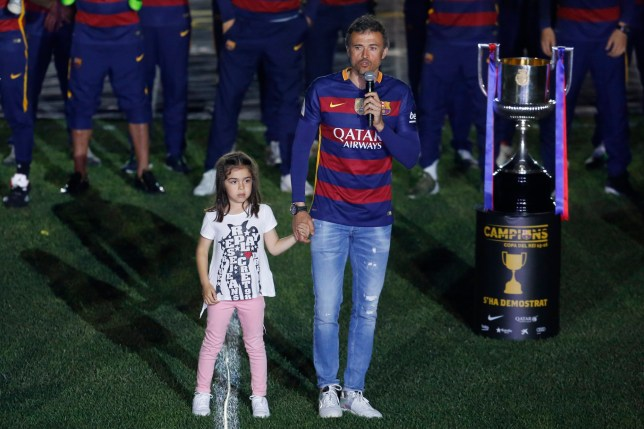 Barcelona's coach Luis Enrique speaks beside his daugther during celebrations at the Camp Nou stadium in Barcelona on May 23, 2016 following their Spanish