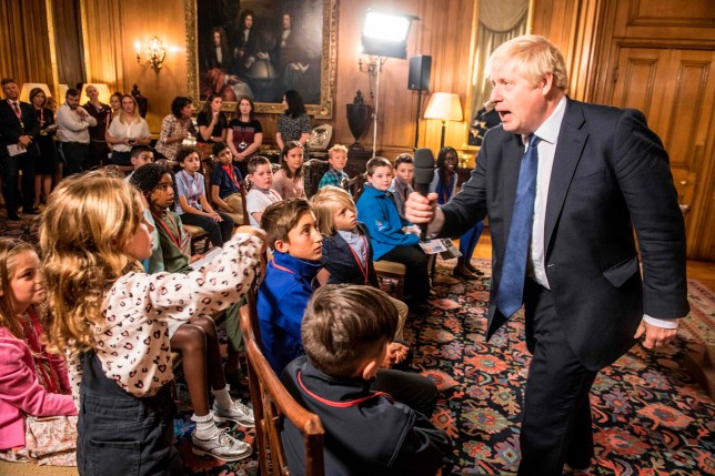 """Britain's Prime Minister Boris Johnson takes questions from young people aged 9-14 during an event inside 10 Downing Street in London on August 30, 2019 ahead of an education announcement. - British Prime Minister Boris Johnson on August 30 warned any attempt by MPs next week to stop Brexit or delay it beyond October 31 would do """"lasting damage"""" to public trust in politics. (Photo by JEREMY SELWYN / POOL / AFP)JEREMY SELWYN/AFP/Getty Images"""